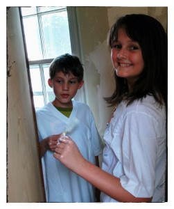 Jaden and Kyler painting the walls